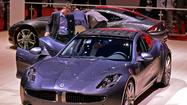 Troubled sports car maker Fisker Automotive Inc. failed to make a $10-million payment on a federal government loan Monday, tipping the Anaheim company closer to a bankruptcy reorganization or liquidation.