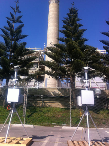 One of the Air Quality Management District monitoring devices is set up next to Pacific Coast Highway and the AES power plant at Newland.