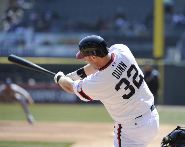 Adam Dunn of the Chicago White Sox hits two-run homer against the Seattle Mariners on April 7.
