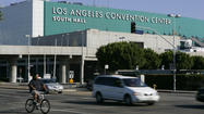 A committee of Los Angeles City Council members voted unanimously Monday to solicit a new round of bids for a private Convention Center operator, ensuring that Anschutz Entertainment Group will have a shot at the contract after being threatened with exclusion.