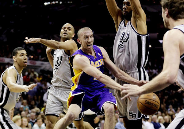 Lakers guard Steve Blake, center, is surrounded by San Antonio Spurs defenders.