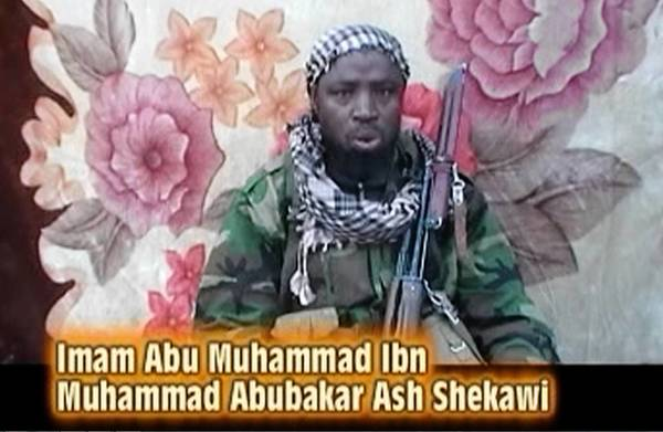 The leader of the Islamist militant group Boko Haram issues a warning in a video image. Boko Haram fighters clashed with Nigeria's military just days after President Goodluck Jonathan offered an amnesty to the group.