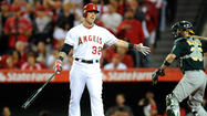 Mike Scioscia dropped struggling right fielder Josh Hamilton from the cleanup spot to fifth in the batting order for Monday night's game against the Texas Rangers, but the Angels manager said the move is not permanent.