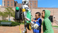 Cycler the recycle robot met with students at Pangborn Elementary School on Monday in the University Plaza in downtown Hagerstown for the City of Hagerstown Earth Day Celebration that featured Mayor David S. Gysberts, Barbara Ingram School for the Arts students, and other local officials.