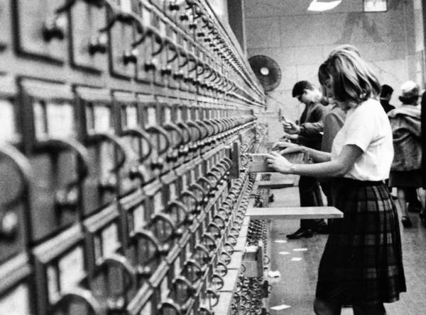 Students check card catalogs at a Chicago public library in 1967. Technology has changed the library experience, but its heart remains books.