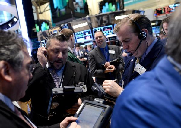 According to a study by personal-finance website Bankrate.com, 76% of individual investors are not more inclined to invest in stocks because of rock-bottom rates on bank savings accounts and certificates of deposit. Above, traders work on the floor of the New York Stock Exchange this month.