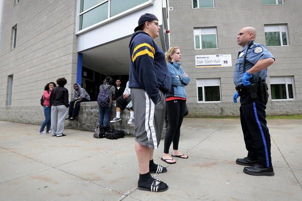 University of Massachusetts Dartmouth students are evacuated from campus Friday as officials investigate the dorm room of Boston Marathon bombing suspect Dzhokhar Tsarnaev.