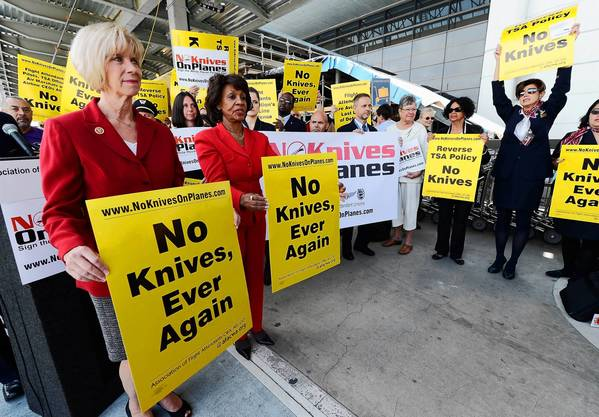 Democratic Reps. Janice Hahn, left, and Maxine Waters protest at LAX earlier this month.