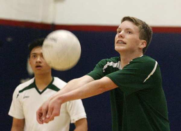 Providence's Kieran McGroarty looks to where he is going to bump the serve into play against Bell-Jeff in a boys volleyball match at Bellarmine-Jefferson High School in Burbank on Monday, April 22, 2013.
