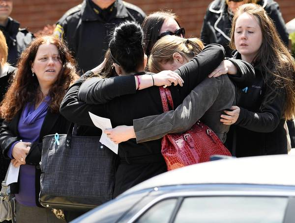 Mourners embrace outside St. Joseph Catholic Church in Medford, Mass., after Krystle Campbell's funeral. The 29-year-old died in the bombing at the Boston Marathon.