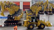 Caterpillar Inc. reported first-quarter results Monday that missed analysts' expectations and lowered its full-year outlook, citing lower sales of mining equipment.