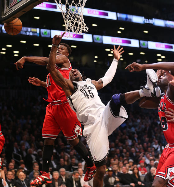 Bulls forward Jimmy Butler knocks the ball away from Gerald Wallace.