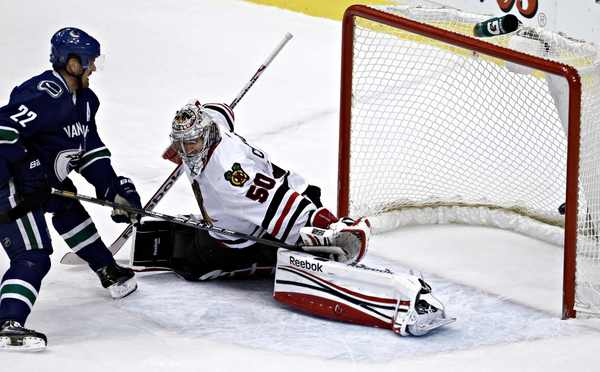 The Canucks' Daniel Sedin scores on Corey Crawford in the second period. (Andy Clark Reuters photo)