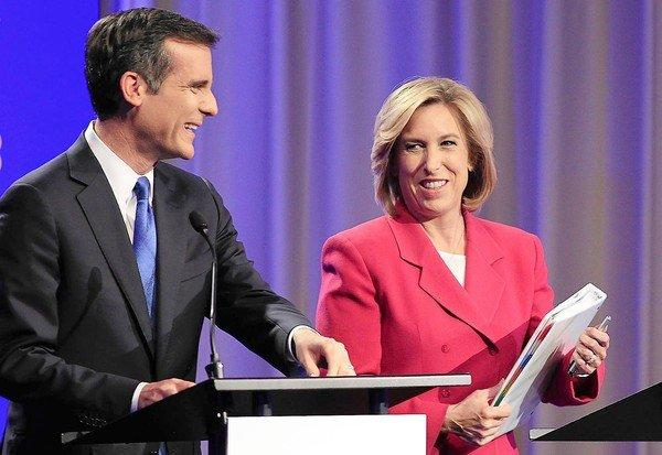 Mayoral candidates Wendy Greuel and Eric Garcetti prepare for their debate. The election is four weeks away but voting by mail begins this week.