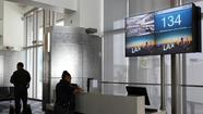 Operations personnel at Los Angeles International Airport late Monday were reviewing their computer systems to determine how multiple flight status boards were hacked to show an emergency message, authorities told The Times.