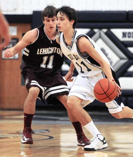 Lehighton's Tyler Crum (11) defends Northern Lehigh's Matt Egan in the Slatington Rotary Invitational Basketball Tournament held at Northern Lehigh High School last December.