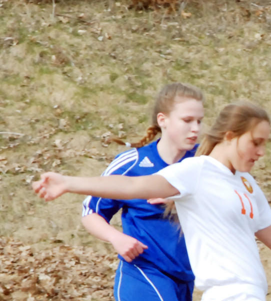 Harbor Springs freshman Mia Trabucchi (middle) works the ball away from a pair of Kalkaska players during Monday's Lake Michigan Conference match at Ottawa Stadium in Harbor Springs. The Rams defeated the Blazers, 8-0.