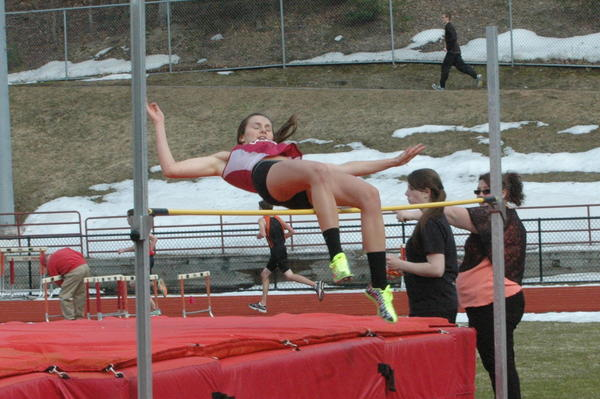 Charlevoixs Madeline Boss leaps over the bar during the high jump Monday in East Jordan. Boss won the high jump with a height of 4 foot, 8 inches. Boss also won the long jump with a distance of 14 feet, 6.75 inches and was a part of the Rayders 800-meter and 1600-meter relay winning teams.