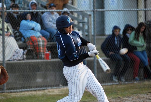 Petoskey senior third baseman Nate McGann makes contact with a pitch during the second game of Monday's Big North Conference doubleheader against Traverse City Central at Turcott Field. The Northmen swept the Trojans, 10-9 and 2-1.