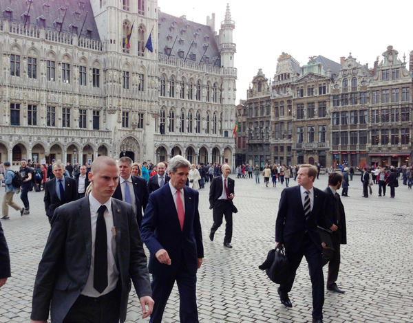 Secretary of State John Kerry and senior staff walk through the Grand Place in Brussels on Tuesday. Kerry began his first NATO foreign ministers meeting by talking about the need to make plans for action against a potential chemical weapons attack in Syria.