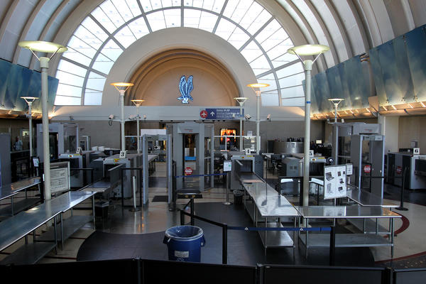 A security screening area stands idle at Tom Bradley International Terminal at Los Angles International Airport.