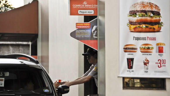 A customer buys food at a McDonald's drive-thru in Sao Paulo, Brazil, in 2011.