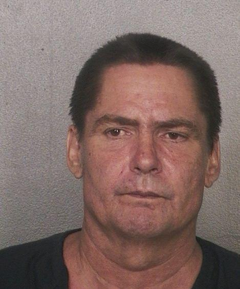 Douglas Scott, 51, is charged with premeditated murder and accused of fatally stabbing his father Norm Scott, 80.