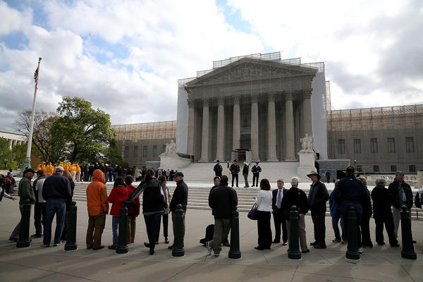 People line up to enter the Supreme Court.