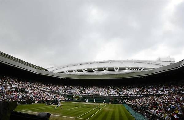 Rain clouds hang over Centre Court before a rain shower during the men's singles final tennis match between Andy Murray of Britain and Roger Federer of Switzerland at the Wimbledon Tennis Championships in London.