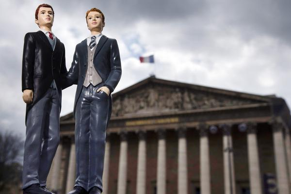 Plastic figurines set up in front of the Palais Bourbon, the seat of the French National Assembly.