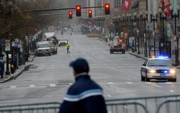 Officials were slowly reopening Boylston Street in Boston to residents and business owners Tuesday after the April 15 Boston Marathon bombings.