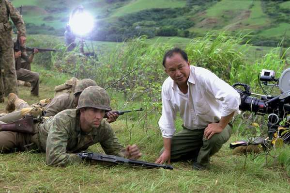 "John Woo, right, directs Nicolas Cage on the set of ""Windtalkers."""
