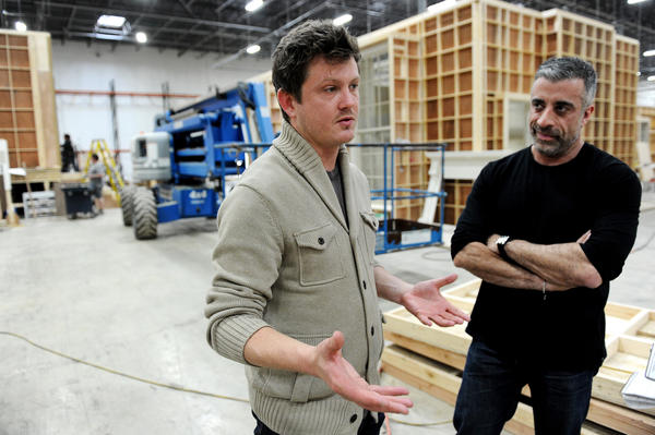 "Beau Willimon (left) and producer John Melfi discuss set construction of ""House of Cards"" in Joppa."
