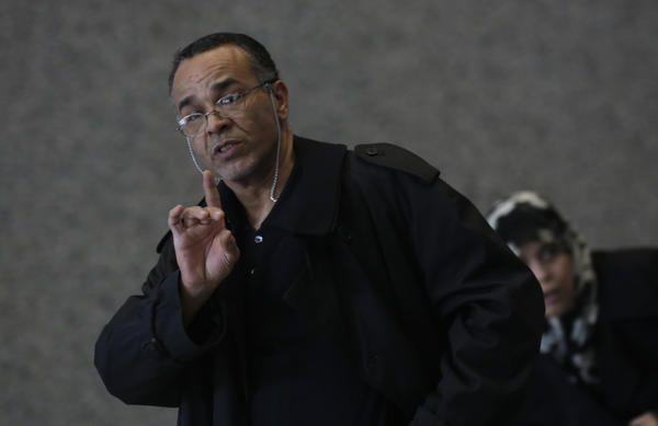 Ahmad Tounisi waves off reporters as he arrives at the Dirksen U.S. Courthouse on Tuesday for a hearing for his 18-year-old son Abdella Ahmad Tounisi, on a charge of material support to a foreign terrorist organization, a felony offense.