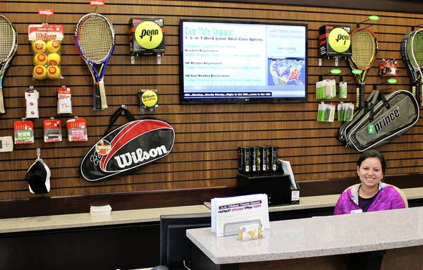 Winnetka Park District employee Alexandra Maestre sits behind a desk in the recently renovated A.C. Nielsen Tennis Center at 530 Hibbard Road.