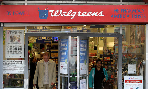 Customers walk out of a Walgreens store in San Francisco, California.
