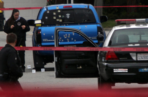 Police officers fired on this blue Toyota Tacoma, injuring two women delivering newspapers, during the manhunt for fugitive ex-cop Christopher Dorner.
