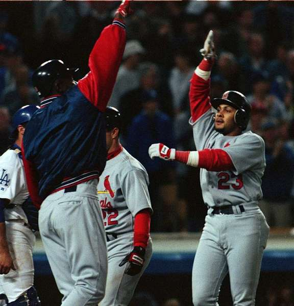 Fernando Tatis, right, is greeted at home plate after hitting his second grand slam in the same inning off of Chan Ho Park on April 23, 1999.