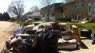 Plainfield and Bolingbrook residents and officials spent much of this week drying out and assessing the cost of the damage of last week's floods.