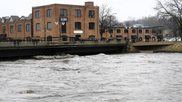 The Fox River on April 18 nearly as high as the Illinois Street bridge in St. Charles.