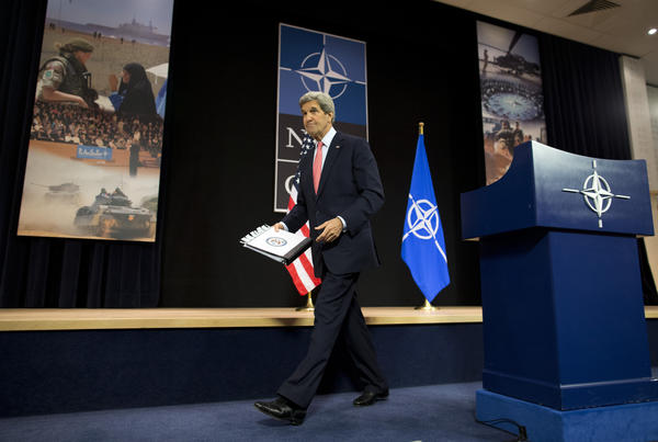 U.S. Secretary of State John F. Kerry finishes up at a news conference at NATO headquarters in Brussels.