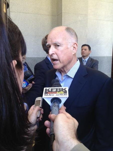 Gov. Jerry Brown speaks to reporters at the state Capitol on Tuesday.