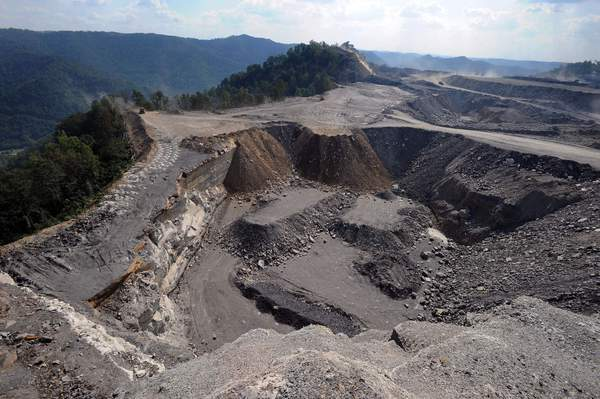 A mountaintop removal mining site at Kayford Mountain, W.Va., with Coal River Mountain, left, in the background.