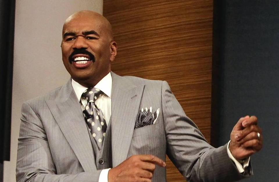 "Steve Harvey, host of the ""Steve Harvey"" show, dances with Dr. Phil after ""teaching him a few moves"" during a taping of the show on Tuesday."