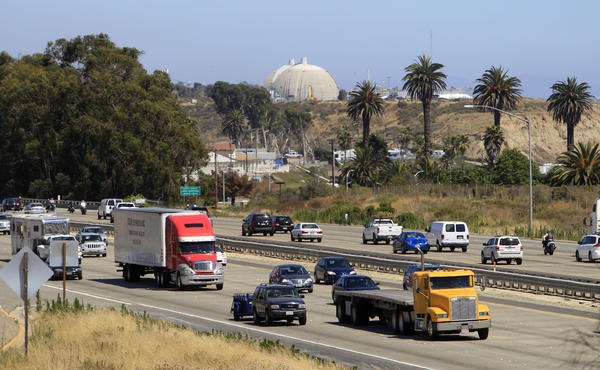 A steady flow of traffic on Interstate 5 runs past the San Onofre Nuclear Generating Station in San Clemente. The Los Angeles City Council called on federal regulators to take more time before making a decision on the plant's fate.