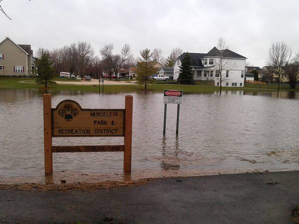 Water in a retention pond at Cardinal Terrace Park in Mundelein was inches away from spilling out onto Courtland Road.