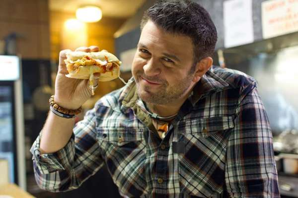 Travel Channel personality Adam Richman.