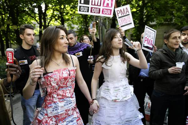 Protesters in favor of gay marriage demonstrate outside the National Assembly in Paris.