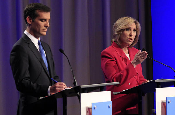 Los Angeles mayoral candidate Wendy Greuel, right, makes a point during Monday's debate with rival Eric Garcetti at USC's Health Sciences Campus.