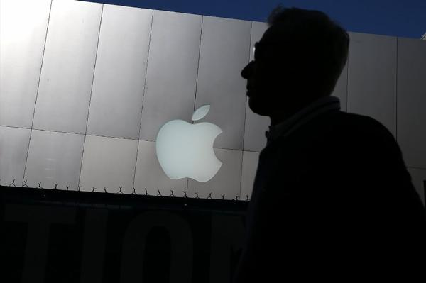 A person walks by an Apple store Tuesday in San Francisco.